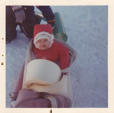 Kass in 1973. She was only one in this picture. Notice the extra padding on her sled. Look at that precious little face!